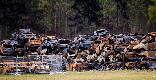 The more than 3,500 rental cars that were destroyed in a massive fire in early April of 2020 next to Southwest Florida International Airport are being stacked and transported away from the site. Trucks from Garden Street Iron and Metal are on the scene hauling the cars away along with another company. Cars from several companies inlcuding Hertz and Avis were destroyed in the fire. Photographed on Monday, May 19, 2020.