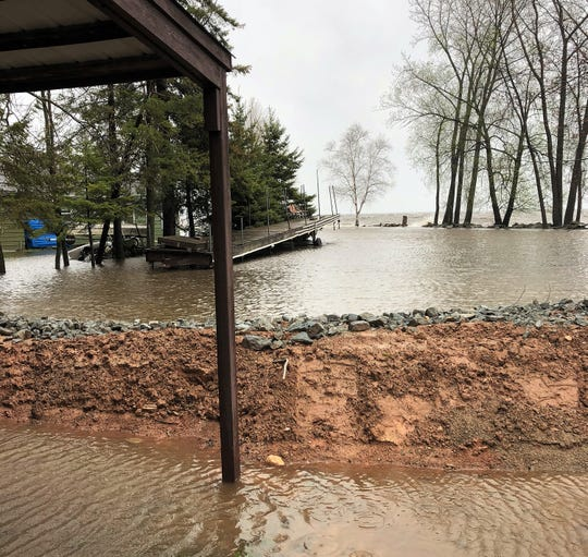 Flooding seen along Lade Beach Road in the town of Little Suamico on Monday.