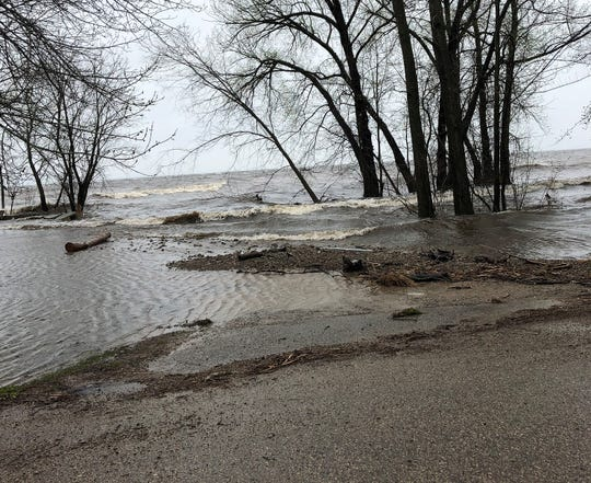 Waves roll in along on Monday afterLade Beach Road in the town of Little Suamico.