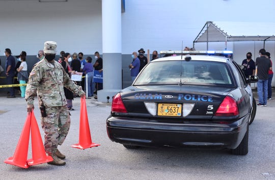 Staff Sgt. Manolito Molinos of the Guam Army National Guard assists with the reopening of the Department of Revenue and Taxation building in Barrigada on May 18, 2020.