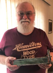Manitowoc's Dennis Ewert with one of his handcrafted kaleidoscopes.