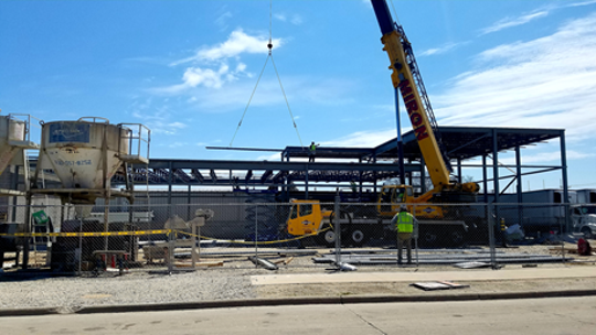 Steel frame being put in place for the Riverside Foods expansion on Wilson Street in Two Rivers in May 2020.
