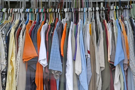 The clothing racks are full off donations at Buckeye Thrift on Park Avenue West.