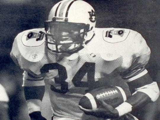 AutoZone Liberty Bowl MVP and future Heisman Trophy winner Bo Jackson scores on a 39-yard touchdown run to highlight Auburn's 21-15 victory over Arkansas on December 27, 1984.