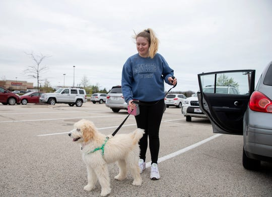 Nevaeh Jozwowski takes her dog home after shopping from Michaels on Tuesday at Grafton Commons in Grafton, Wisconsin.