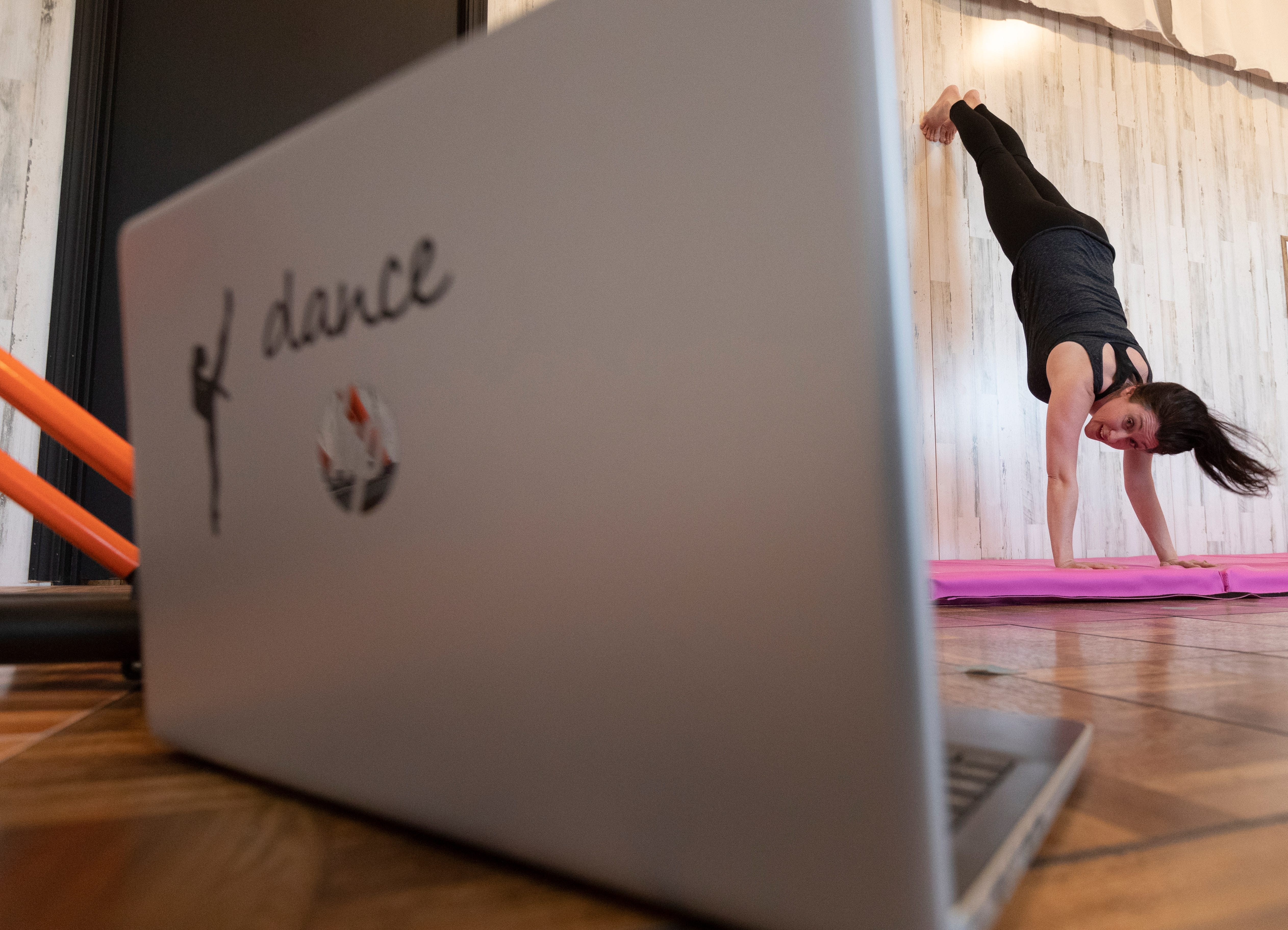 Holly Rohde teaches an acrobatic dance class via Zoom at her recently opened dance studio, Uplifting Movement and Fitness, in Loyal. Rohde opened her business a week before the state-ordered shutdown. Since then she has been teaching some classes online in the studio she created from a defunct gas station.