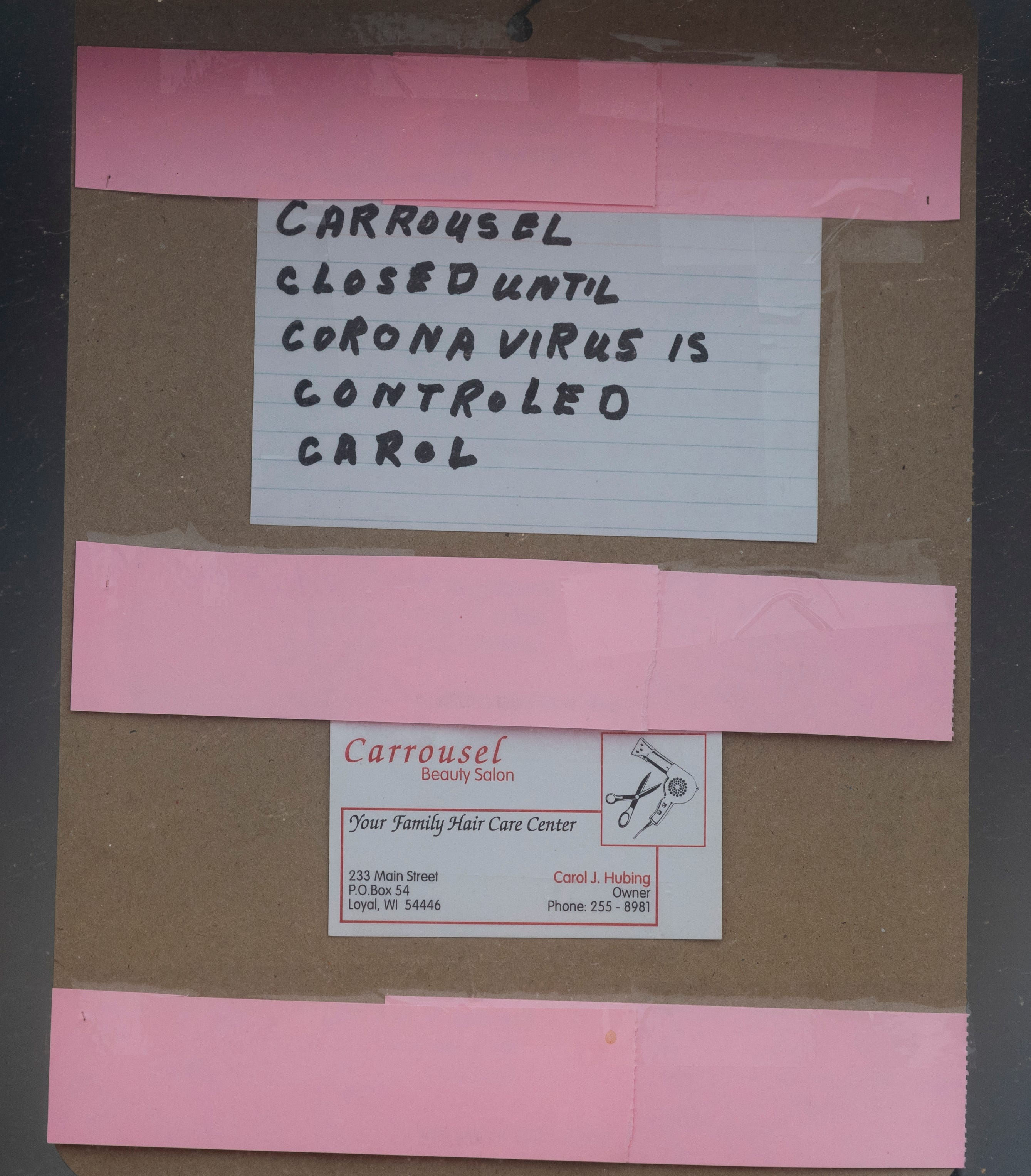 A sign on beauty salon in downtown Loyal tells of its closing due to the coronavirus pandemic.