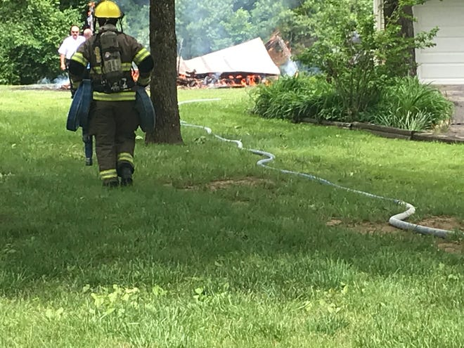 Mountain Home firefighters are on the scene of a shed fire on Marquis Drive as of 2:28 p.m. No one appears to have been injured as a result of the fire that destroyed the large shed. Firefighters quickly extinguished the blaze that scorched some siding on the home.