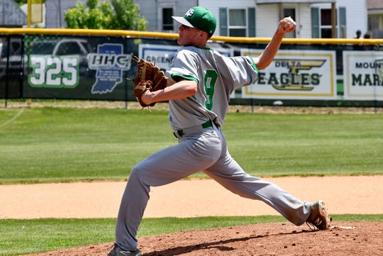 New Castle's Nic Besecker throws a pitch against New Palestine on May 18, 2019. Besecker will continue his playing career at Virginia Military Institute.