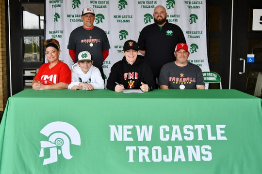 New Castle pitcher Nic Besecker signs his letter of intent to play at Virginia Military Institute on May 15, 2020.