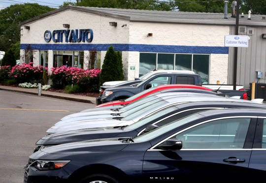 The City Auto of Murfreesboro office and cars lined up at the lot on Tuesday, May 19, 2020. Despite the worldwide pandemic, the dealership said that its sales are actually higher than normal.