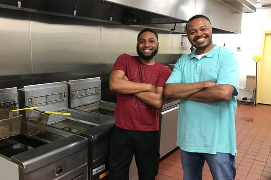 Bee Hive Bistro owners Michael Malone, left, and Tim Otis stand in the kitchen of their new Murfreesboro restaurant.