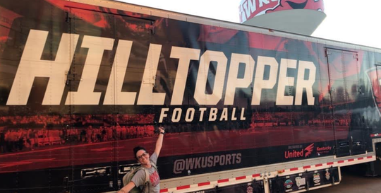 Former Smyrna and Western Kentucky football manager Hannah Potter stands in front of a Hilltopper truck prior to a past road trip. Potter has landed an internship with the Indianapolis Colts.