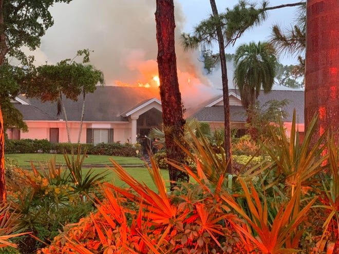 A house fire in the 100 block of East Avenue in North Naples burns on May 18, 2020.