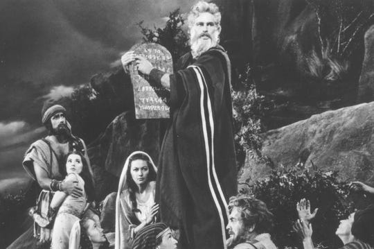 """Yvonne De Carlo at the feet of Charlton Heston, as Moses, in """"The Ten Commandments"""""""