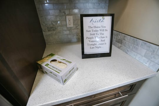 Arista Development offers gloves during a self-guided tour at one of their model homes in the Sonoma Ranch area of Las Cruces on Tuesday, May 19, 2020.