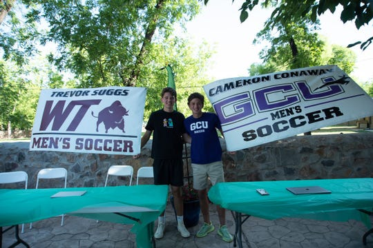 Mayfield soccer players Trevor Suggs, left, and Cameron Conaway, signed to play college soccer recently. Suggs and Conaway have been teammates since they were four years old.