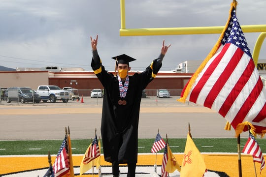 Alamogordo High School Senior William Gil walks up the stage to receive his diploma at the AHS 2020 Graduation.  Due to COVID-19 coronavirus restrictions,  AHS held a socially distanced graduation ceremony.