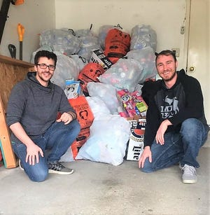 Canton residents Brandon Pritz (left) and Brandon Leighton will buy your empties and de-clutter your garage.
