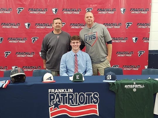 Franklin's Alex Forry poses with head baseball coach Matt Fournier and assistant coach Dan Hejka on signing day.