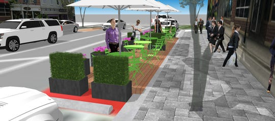 A rendering of what outdoor dining could look like in Milford this summer, with platforms over parallel parking spaces.