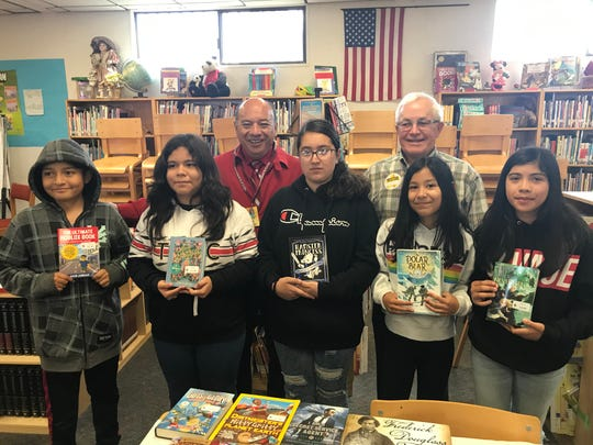Mecca Elementary School Principal Dr. Armando Rivera is photographed with students and Read With Me Volunteers supporter Gary Severtson.
