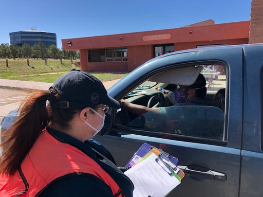 Brent Harrison, a senior at Diné College, was among nearly 38 vehicles in line to receive CARES Act stimulus checks at the college's main campus in Tsaile on May 13, 2020.