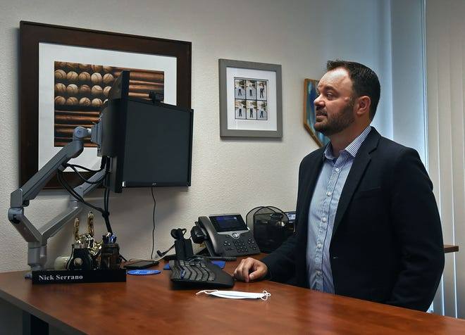 Nick Serrano stands in his office at Greater Nevada Mortgage in Reno, Nevada on May 19, 2020.