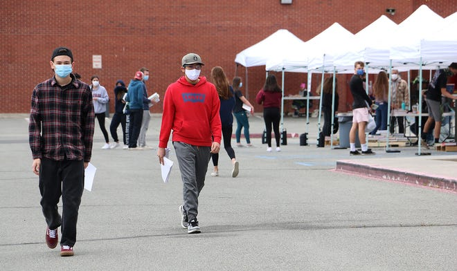 Students return their text books and pick up their belongings at Reno High School on May 19, 2020.