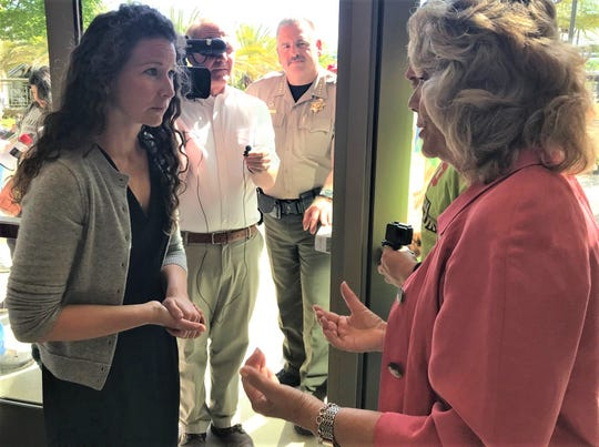 Elissa McEuen of Millville spoke with county Supervisor Mary Rickert during a break in the Board of Supervisors meeting Tuesday.