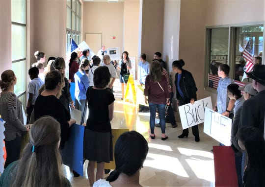 Dozens of people met outside the Shasta County Board of Supervisors meeting room to urge the board to ease restrictions on people, schools and businesses.