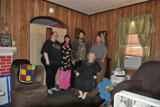 John Peters, right, and Sheryl Peters, seated, share their house with friends but are worried they will not be able to refinance their mortgage, which is more than their house is worth.