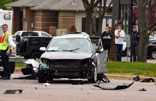 The front end of a car involved in a crash is smashed in on Tuesday, May 19, at 61st Street and Cliff Ave. in Sioux Falls.