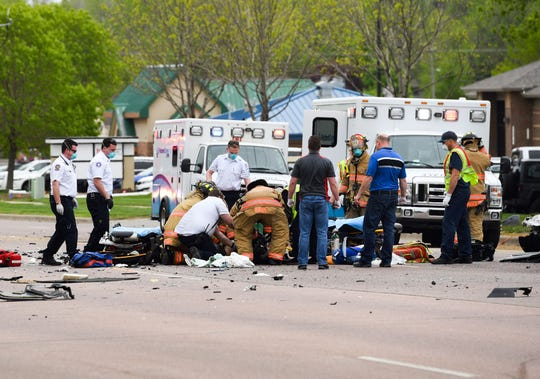 Emergency personnel respond to a car crash on Tuesday, May 19, at 61st Street and Cliff Ave. in Sioux Falls.