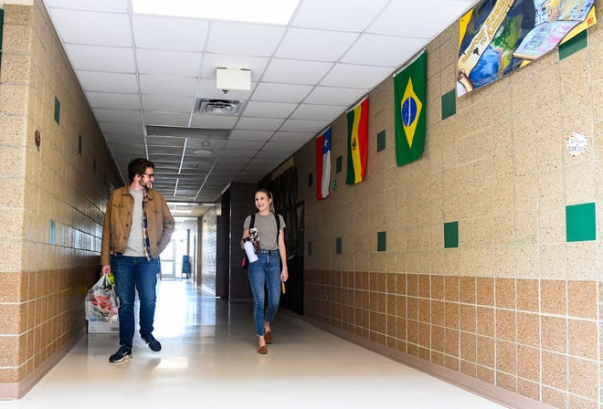 Third grade teacher Liz Magnuson, right, runs into fellow third and fourth grade teacher Nathan Downs as she walks the halls before leaving it for the summer on Friday, May 15, at Rosa Parks Elementary in Sioux Falls. Only a few teachers are allowed in the building at one time, so finding another person while working is a rare occurrence.