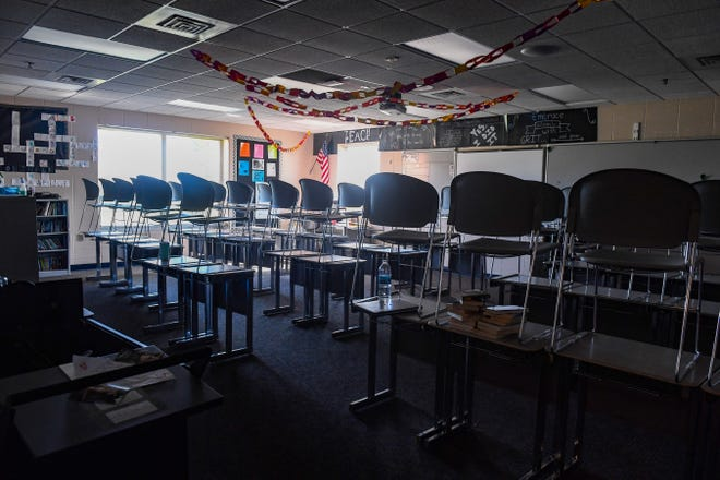 Chairs are stacked on tables in Tracie Robinson's classroom on Monday, May 11, at Memorial Middle School in Sioux Falls.