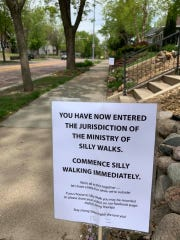 """Jill Johnson set up a sign establishing her stretch of sidewalk near 26th Street and Phillips Avenue as under """"the jurisdiction of the Ministry of Silly Walks."""""""