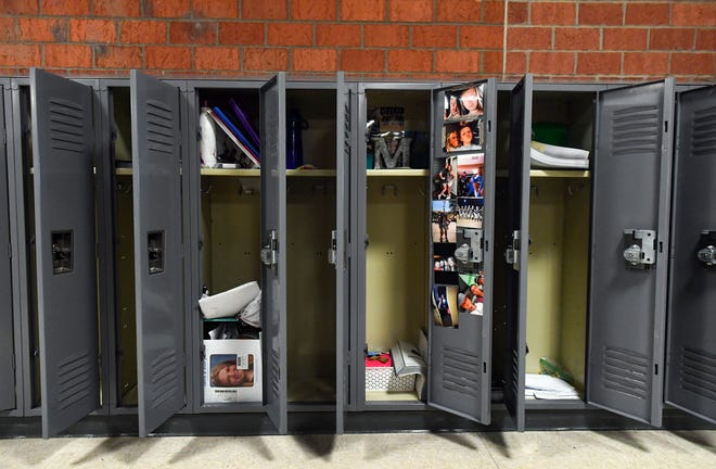 Lockers full of students' belongings stand open in the empty hallways on Monday, May 11, at Memorial Middle School in Sioux Falls.