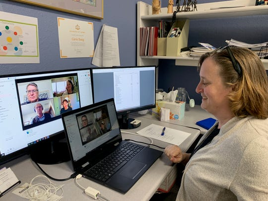 Carrie Essig participates in an executive meeting on Zoom during the COVID-19 pandemic.