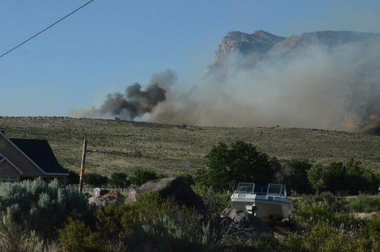 Local, state and federal agencies work to fight a fire that broke out near Toquerville Monday afternoon.