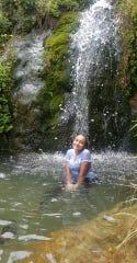 El Pasoan Khadijah Gilstrap enjoys the waterfall at Sitting Bull Falls in New Mexico.