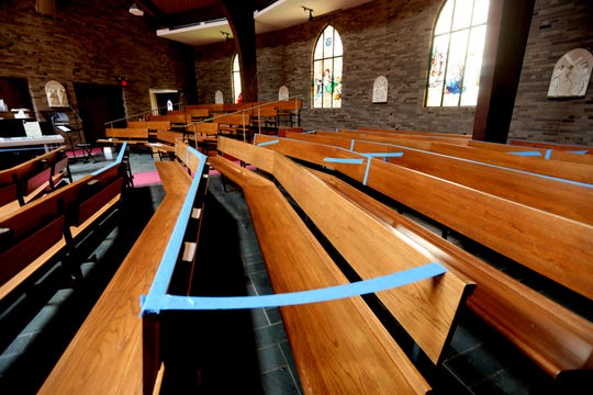 In anticipation of being able to hold services inside the church sanctuary once the coronavirus quarantine is lifted, Fr. Emiel Abalahin of the Transfiguration Church in Tarrytown, N.Y. has taped off sections of the pews so that social distancing among parishioners can be maintained.