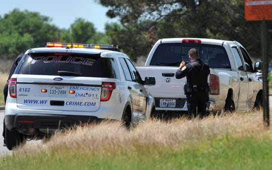 Wichita Falls police investigate a possible stolen vehicle on Loop 11 Monday morning.