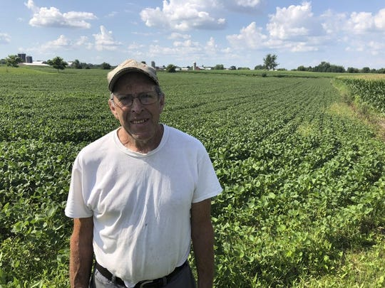 Farmer Michael Slattery stands in front of his soybean field, Tuesday, July 24, 2018, in Maribel, Wis. He and his wife farm 300 acres of mostly soybean and corn, but they also have wheat and alfalfa.