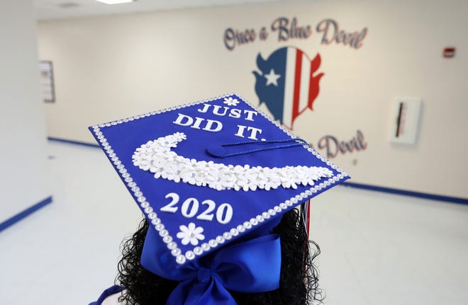 Zanesville High School graduated its seniors over four days, walking them through the halls of the schools and across a stage to collect their diplomas at five-minute intervals.
