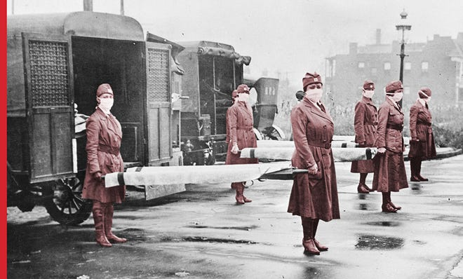 Members of the St. Louis Red Cross Motor Corps carry stretchers during the 1918 influenza epidemic.