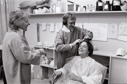 Hamill (sitting) works with make-up artists Kay Freeborn and son Graham Freeborn to make castings for his hand and head during the production of