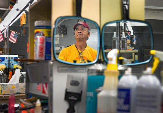 Robert Tony McCurry, owner of McCurry's Barber Shop in Anderson talks about his business and moving forward Wednesday, May 20, 2020. Restrictions have been lifted for many South Carolina businesses that were closed to state mandated orders during the coronavirus pandemic.