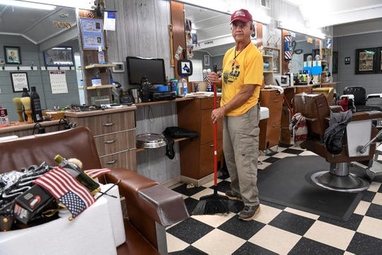 Robert Tony McCurry, owner of McCurry's Barber Shop in Anderson cleans his shop and talks about his business Wednesday, May 20, 2020. Restrictions have been lifted for many South Carolina businesses that were closed to state mandated orders during the coronavirus pandemic.