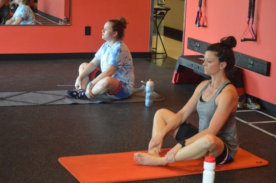 Hannah Graham (left) and Chastity Bernard stretch during a yoga exercise at FiXX Cycling in Alexandria Tuesday. FiXX Cycling reopened its doors May 15 once Louisiana Gov. John Bel Edwards said the state would enter Phase 1 in the recovery of the COVID-19 pandemic.